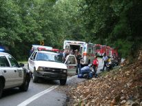 Motorcycle wrecks attract a crowd.